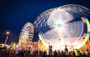 Long exposure photograph of fairground rides at night